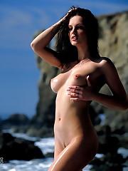 peels off her pink bikini at a beach in Malibu