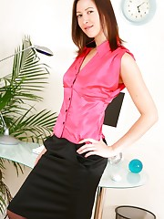 Carole looking stunning in satin top and tight skirt.