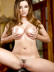 Taylor Vixen squeezes her perky tits and stimulates her..