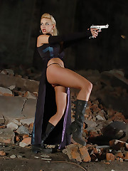 Sexy babe Kathy Lee poses with her favorite gun