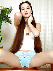 Barenaked nubile Emma loves to tease her well rounded ass..