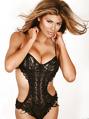 Alluring Vixen Claudia teases in her black lace lingerie..