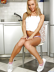 Naughty Nubile Melita gets naked in the kitchen and..