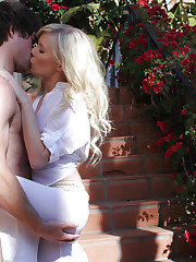 Elaina enjoys her man's cock in the garden.