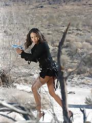 Ebony babe Amber Fox in an action photo shoot