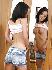 Hot alluring Ludiya admires her perfect tits in the mirror..